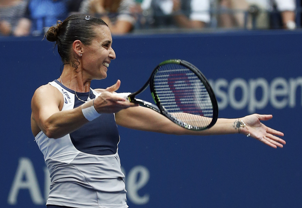 Flavia Pennetta, of Italy, reacts after beating Roberta Vinci, of Italy, during the women's championship match of the U.S. Open tennis tournament on Saturday in New York.