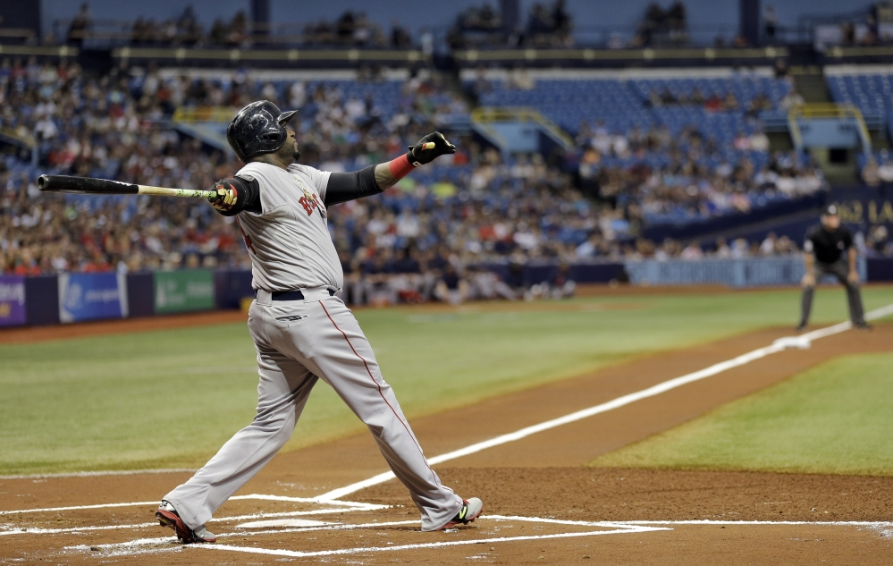 Boston Red Sox's David Ortiz follows the flight of his three-run home run off Tampa Bay Rays starting pitcher Matt Moore in the first inning Saturday in St. Petersburg, Fla.  Boston's Mookie Betts and Xander Bogaerts also scored.