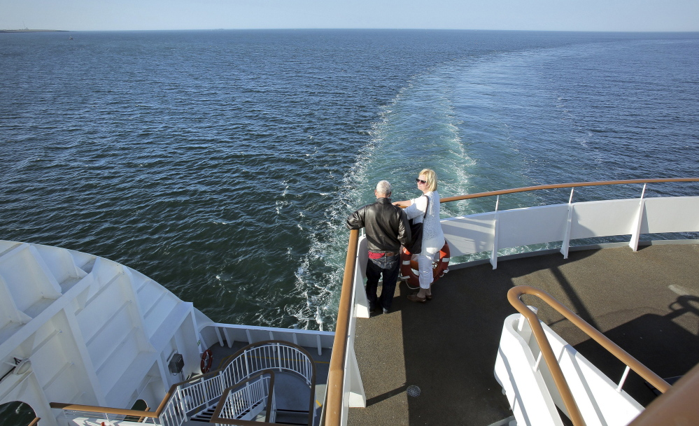 Passengers take in the view on Nova Star's maiden voyage from Portland in May 2014. Despite an erosion in the number of travelers, analysts say there's a solid market of people who prefer transportation by ferry.