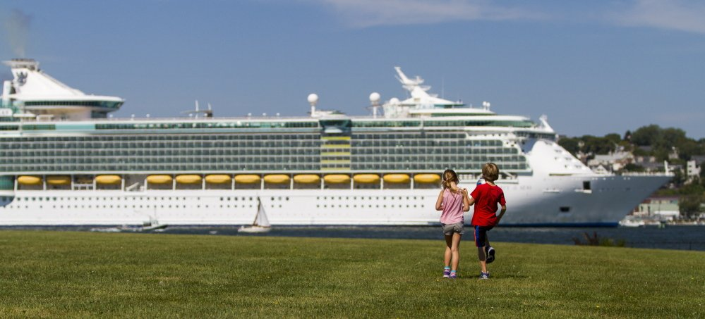 Audrey LeBleu of South Portland and Harry Converse of Cape Elizabeth take a look at the cruise ship Liberty of the Seas from Bug Light Park in South Portland on Saturday.