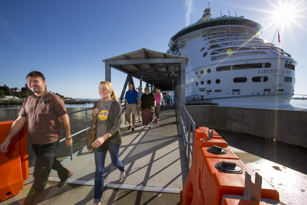 Passengers disembark from the Liberty of the Seas – the largest cruise ship to arrive in Portland this year.