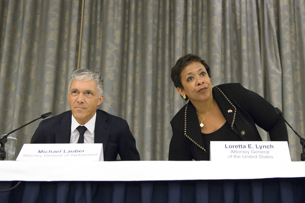 Michael Lauber, attorney general of Switzerland, left, and Loretta Lynch, attorney general of the US, right, arrive for the a news conference on soccer related criminal proceedings, in Zuerich, Switzerland, Monday, Sept. 14, 2015. Lynch expects more indictments in FIFA corruption investigation.