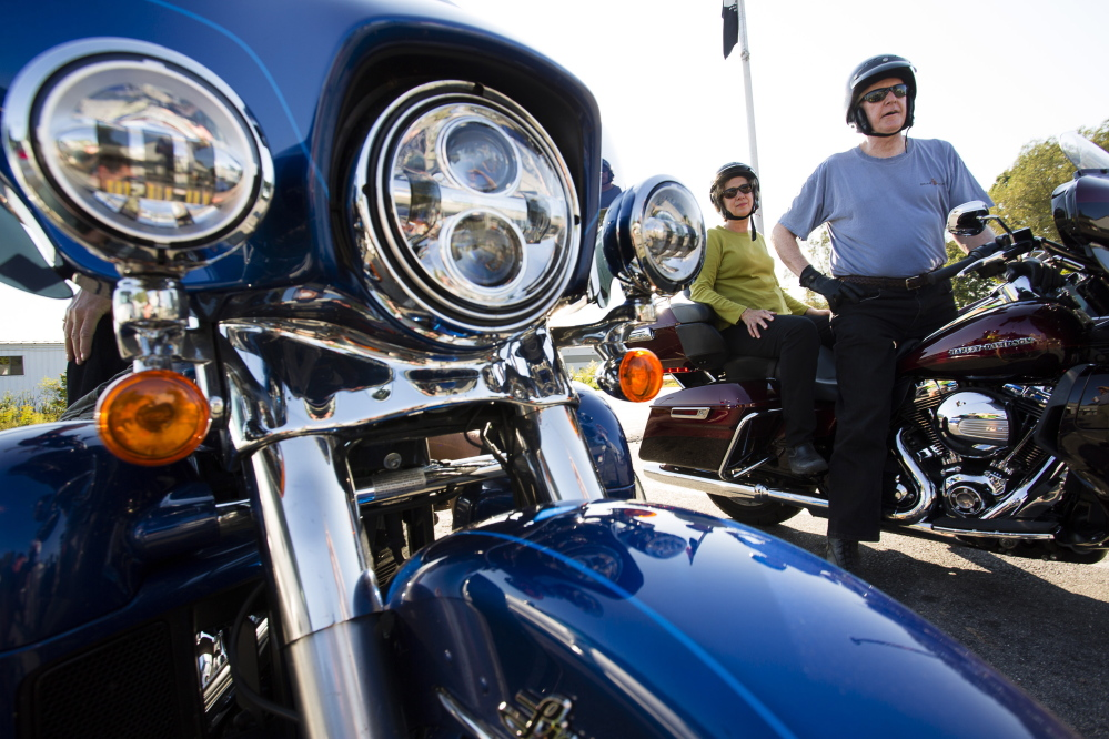 """Darlene and Jay Seaton of New Hampshire talk about motorcycle safety Monday at Big Moose Harley-Davidson in Portland. """"I trust Jay, but I worry about the cars pulling out in front of us,"""" Darlene Seaton said. Derek"""
