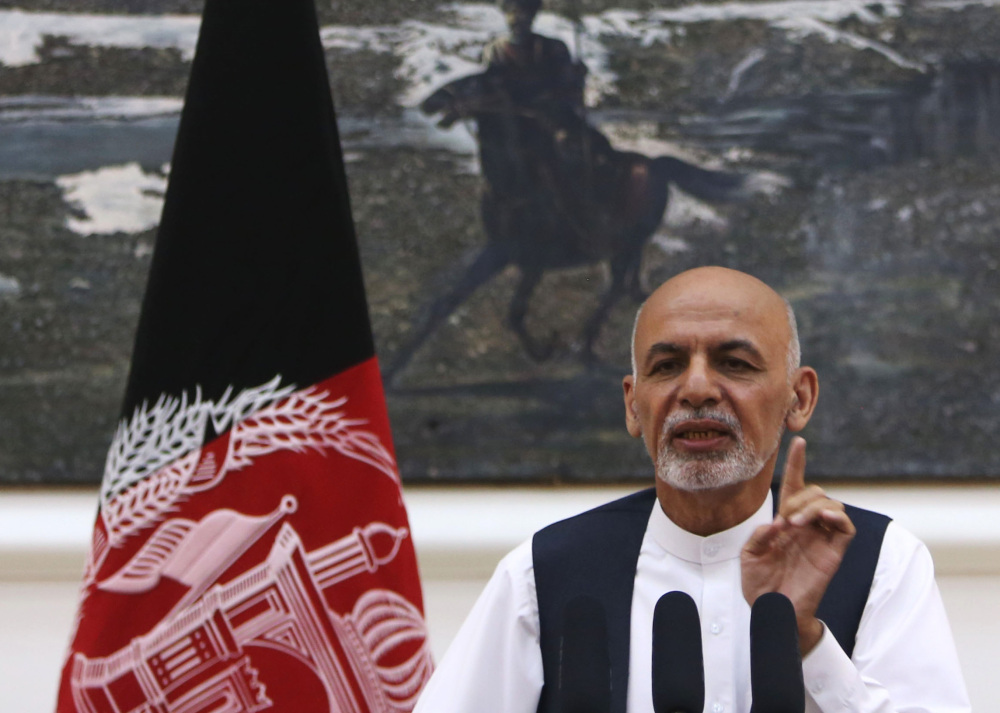 Afghan President Ashraf Ghani speaks at a conference Monday. In the single year since he came to power, applications for passports are up sevenfold.
