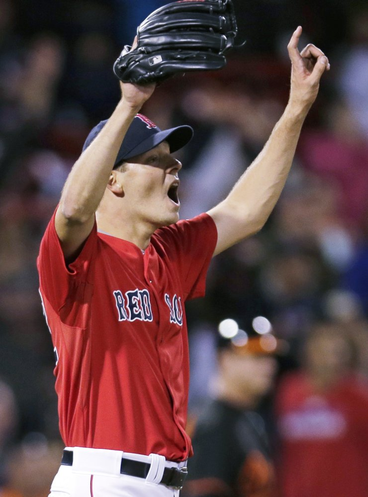 Red Sox starting pitcher Rich Hill reacts to right fielder Mookie Betts' spectacular catch at the bullpen wall for the final out of the ninth inning, preserving Hill's shutout against the Baltimore Orioles.