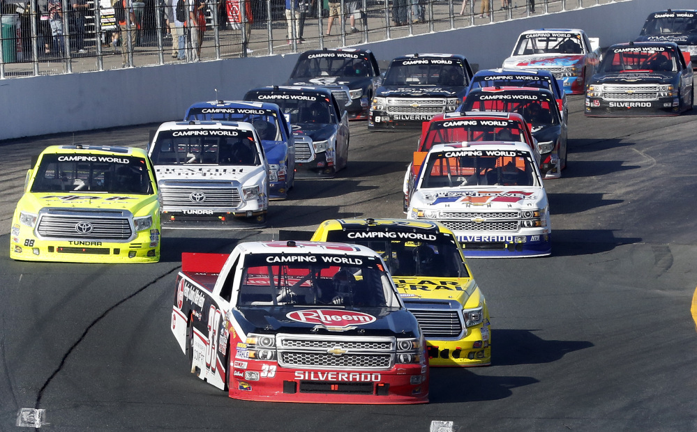 Austin Dillon takes the lead during a restart during the NASCAR Truck Series race at New Hampshire Motor Speedway on Saturday in Loudon, N.H. He went on to win the race. The Associated Press