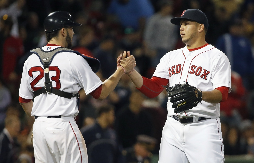 Red Sox's Jonathan Aro, right, and Blake Swihart celebrate after defeating the Baltimore Orioles 8-0 in Boston on Saturday.