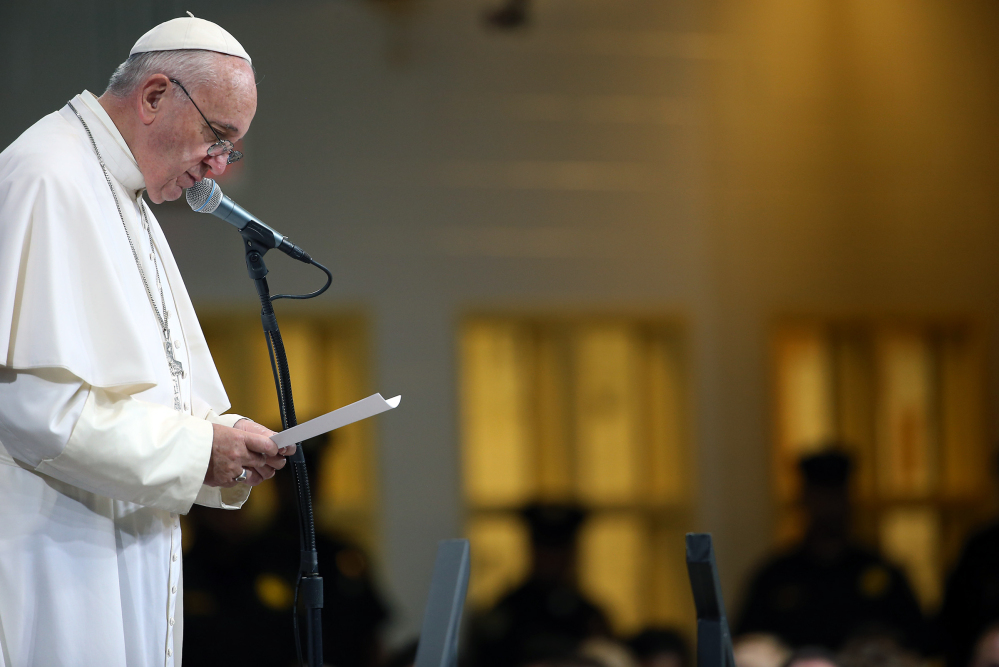 Pope Francis speaks to inmates during his visit to the Curran Fromhold Correctional Facility in Philadelphia on Sunday. The Associated Press