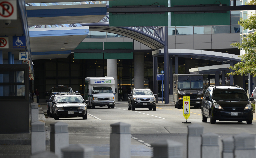 If legislation to let Maine municipalities regulate Uber becomes law, spaces would be designated for Uber drivers outside the Portland jetport, above, so the drivers don't clog the cellphone lot or pickup areas while awaiting fares.