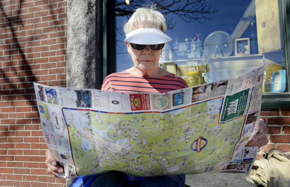 Catherine Guzi, 73, of South Carolina plans her next stop while visiting the Old Port in Portland. The cruise ship Aurora, carrying nearly 2,000 passengers, docked Monday in the harbor. By one estimate, 48 percent of U.S. cruise ship passengers are 50 or older.