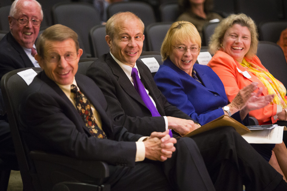 Maine Turnpike Authority Executive Director Peter Mills, left, sits with his brother Paul Mills, a Farmington lawyer and history expert, and his sisters Janet Mills, Maine's attorney general, and Dora Anne Mills, former state public health director, at USM's Portland campus Monday night. They received the Maine History Maker Award from the Maine Historical Society.