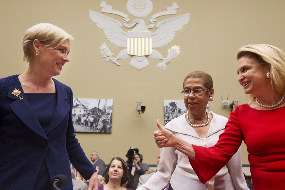 House Oversight and Government Reform Committee member Rep. Carolyn Maloney, D-N.Y., right, accompanied by fellow committee member Del. Eleanor Holmes Norton, D-D.C., center, gives a thumbs-up to Planned Parenthood Federation of America President Cecile Richards, prior to Richards testifying before the committee Tuesday on Capitol Hill in Washington.