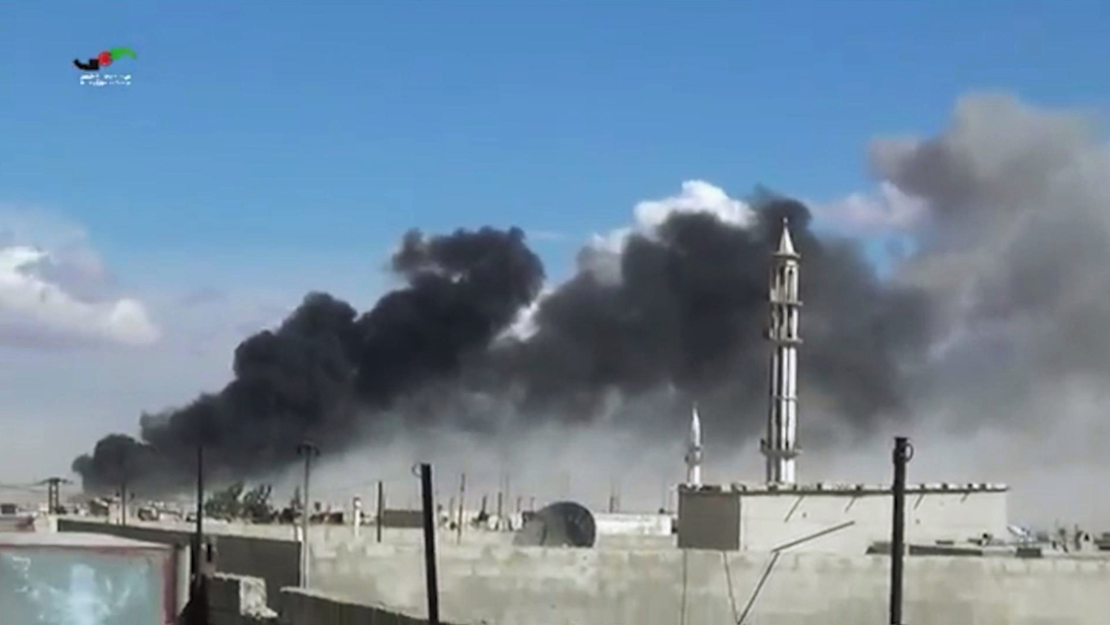 Smoke rises after airstrikes by military jets in Talbiseh of the Homs province in western Syria on Wednesday. Russian military jets carried out airstrikes in Syria for the first time on Wednesday.