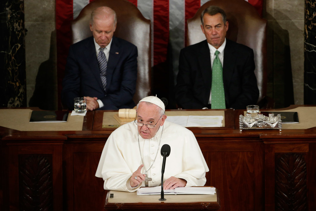 Pope Francis addresses a joint meeting of Congress on Capitol Hill in Washington on Thursday, making history as the first pontiff to do so. Behind the pope are Vice President Joe Biden and House Speaker John Boehner of Ohio.