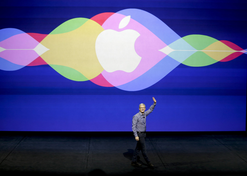 Apple CEO Tim Cook opens the Apple event at the Bill Graham Civic Auditorium in San Francisco, Wednesday. The Associated Press