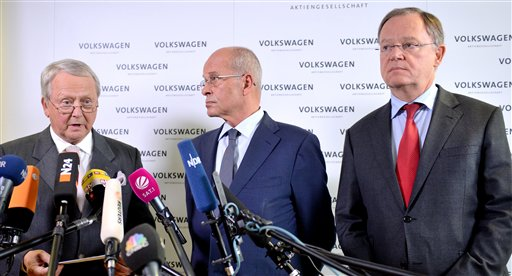 Volkswagen supervisory board member Wolfgang Porsche, left, acting board head Berthold Huber, and Stephan Weil, governor of Lower Saxony and member of the board, announce that CEO Martin Winterkorn stepped down. The Associated Press