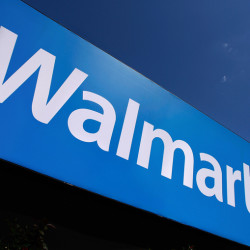 In this May 16, 2011 photo, the Wal-Mart logo is displayed in Springfield, Ill. What Wal-Mart Stores Inc. says about how it's reversing a slump in its namesake U.S. business will be at the front of analysts' minds at the company's annual meeting with Wall Street Wednesday, Oct. 12, 2011.  (AP Photo/Seth Perlman)