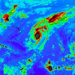For a time Saturday night, three Category 4 hurricanes churned in the central and eastern Pacific, the first time such an event had been recorded. From left: Kilo, Ignacio and Jimena. NASA image