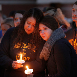 Dina Bahloul, left, and Alexi Galley, seniors at Maine Martime Academy, embrace at the start of a vigil on Tuesday evening at the school in Castine. The two are friends of Dylan Meklin and his girlfriend, Jordan Dillinger. Meklin is one of the four Mainers who were aboard the cargo ship El Faro and are missing. Gregory Rec/Staff Photographer