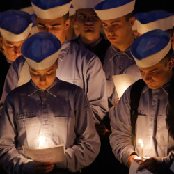 CASTINE, ME - OCTOBER 6: Maine Maritime students listen during a reading at a vigil at the school in Castin on Tuesday, October 6, 2015. Four Mainers who were aboard the cargo ship El Faro, Capt. Michael Davidson of Windham, Michael Holland of Wilton, Danielle Randolph of Rockland and Dylan Meklin, both of Rockland, are all graduates of Maine Maritime Academy. (Photo by Gregory Rec/Staff Photographer)