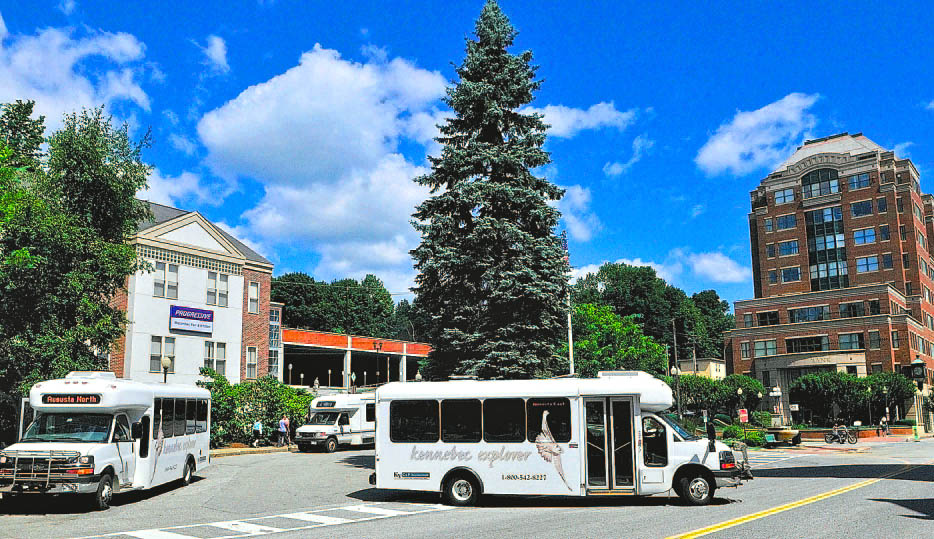"""Kennebec Explorer bus routes converge at Market Square in downtown Augusta in 2011. Augusta is one of the stops on the experimental """"Cultural Explorer"""" route this weekend, that will ferry people to and from the three festivals in Waterville this weekend."""