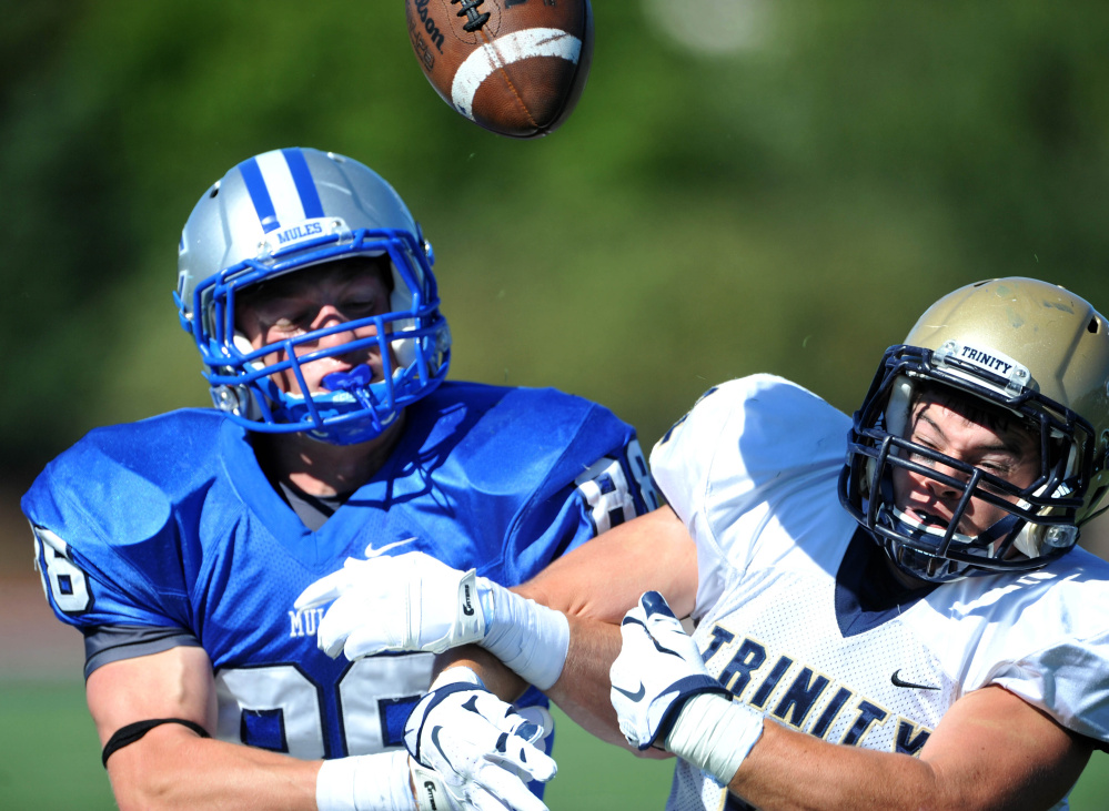 Trinity's Paul McCarthy (32) breaks up a pass intended for Colby's Mark Snyder last Saturday. The Mules return to action Saturday at Middlebury.