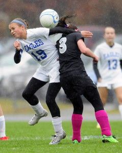 Staff file photo by Joe Phelan   Erskine midfielder Avery Bond, left, makes contact with Lincoln midfielder Olivia York during a game in South China last October.