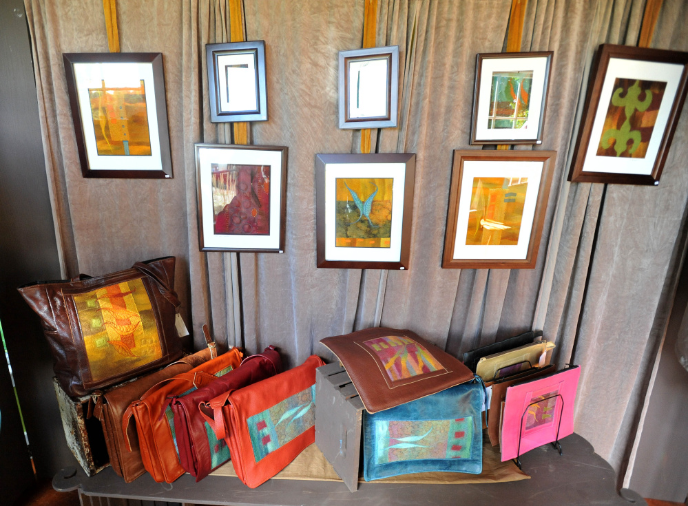 Items created with handmade felt by Heather Kerner hang on display Saturday in the entryway to her Pinnacle Road residence in Canaan. Kerner had opened her home as part of the Wesserunsett Arts Council's sixth annual open studio tour.