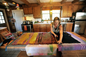 Heather Kerner demonstrates how she creates felt designs Saturday on her kitchen table at her family's Pinnacle Road residence in Canaan during the Wesserunsett Arts Council's sixth annual open studio tour.