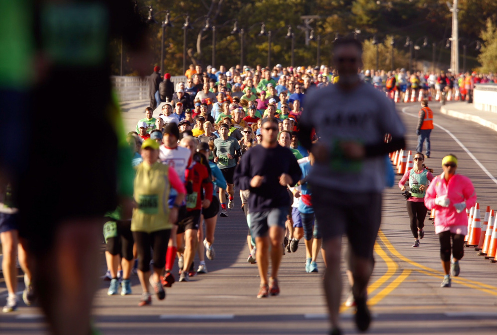 Maine Marathon runners cross the Route 1 bridge into Falmouth during Sunday's race.