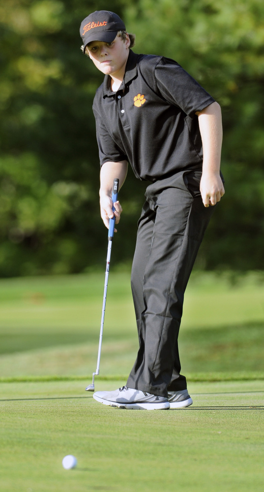 Gardiner Area High School's Cody Rizzo putts during a match against Lincoln Academy last month at The Meadows in Litchfield.