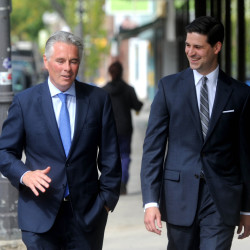 Staff file photo by Micheal G. Seamans Colby College President David Greene and Waterville Mayor Nick Isgro walk down Main Street in downtown Waterville on Tuesday last week. Greene will be at Tuesday's City Council meeting to discuss the college's plans for downtown Waterville.