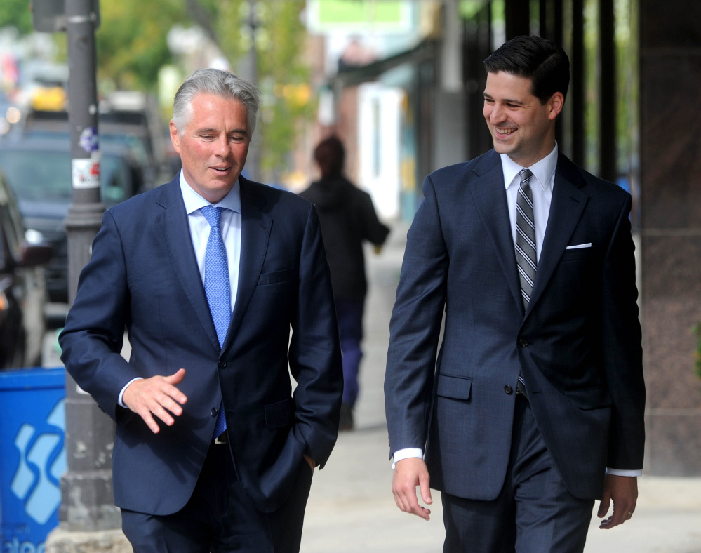 Colby College President David Greene and Waterville Mayor Nick Isgro walk down Main Street in downtown Waterville in October 2015.