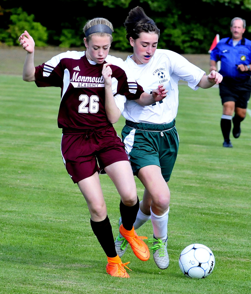 Staff photo by David Leaming   Monmouth's Emily Grandahl, left, and Carrabec's Katrina Mason compete for possession during a Mountain Valley Conference game Monday afternoon.
