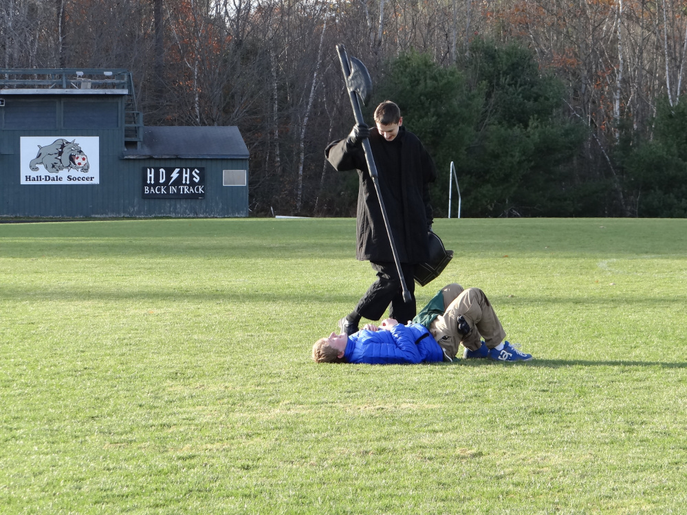 """The Black Knight (Nate Stahlnecker) stands over his """"victim"""" (Barry Nitzel) after a duel at last year's LARPing event."""