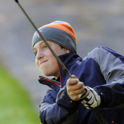 Staff photo by Andy Molloy Erskine Academy's Justin Brown watches a shot during the Kennebec Valley Athletic Conference Class B state golf qualifier Tuesday at Natanis Golf Course in Vassalboro. Brown shot an 84, which earned him a spot in the state championships.