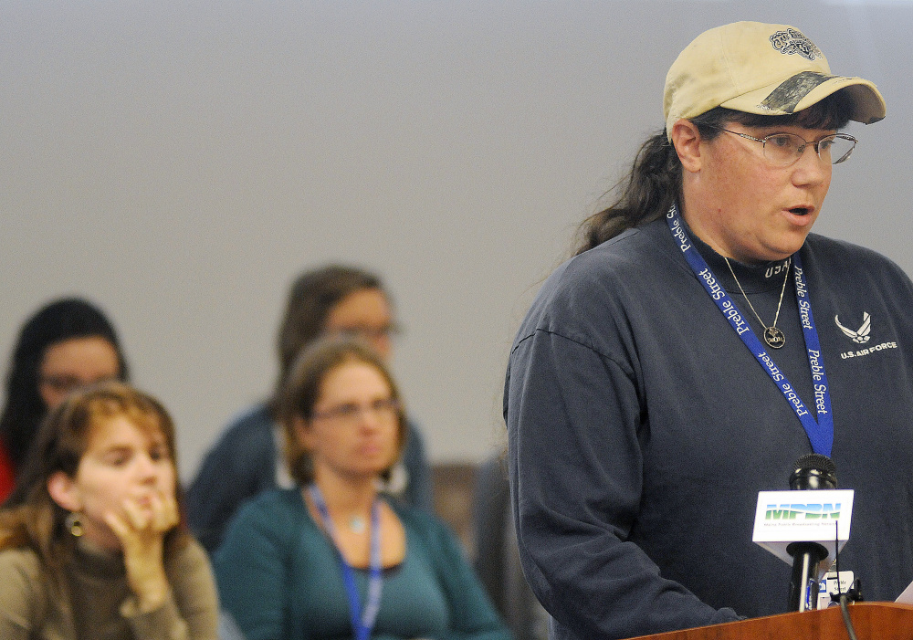 Veterans advocate Keri Dunton speaks against a proposal by the Department of Health and Human Services to conduct asset tests on people receiving state-administered aid during a hearing Tuesday in Augusta. An Air Force veteran from Bangor, Dunton works for Preble Street Veteran Services.