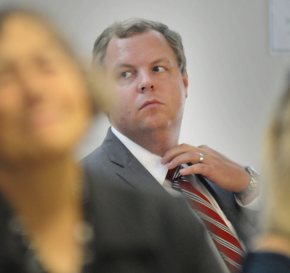 David Sorenson, spokesman for the Department of Health and Human Services, listens to testimony Tuesday during a hearing in Augusta about the agency's proposal to conduct asset tests on people receiving state-administered aid.
