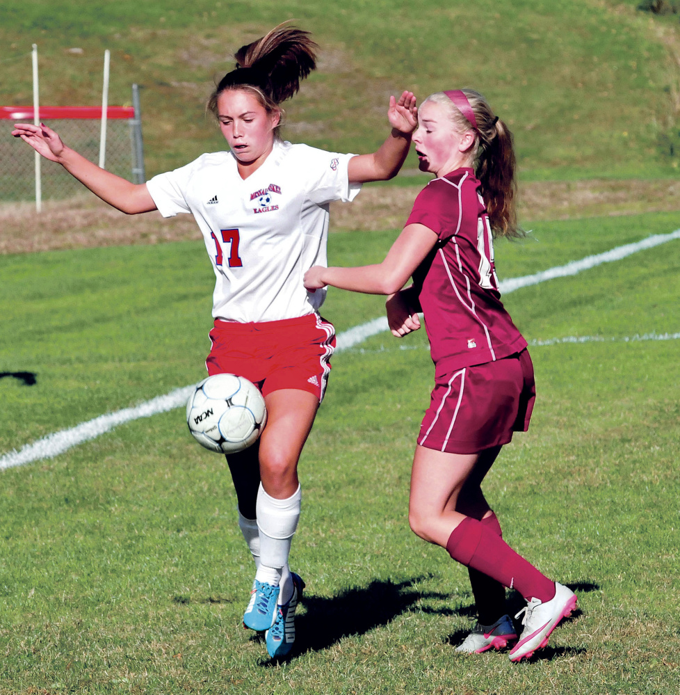 Staff photo by David Leaming   Messalonskee's Edin Sisson, left, tries to maintain possession of the ball as Bangor's Maddi Cormier defends during a Kennebec Valley Athletic Conference Class A game Tuesday in Oakland.