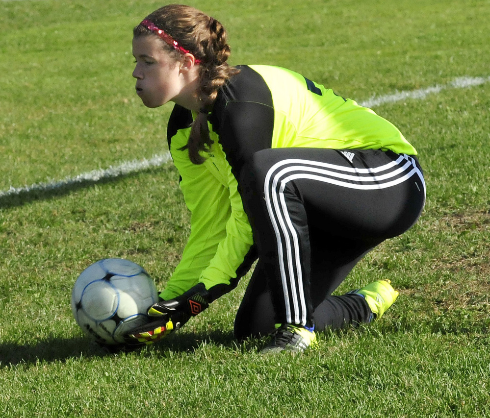 Staff photo by David Leaming Messalonskee keeper Sarah Van Der Karr makes a save during a Kennebec Valley Athletic Conference Class A game against Bangor on Tuesday in Oakland. Van Der Karr, who filled in for the injured Taylor Easer, was strong in net with 14 saves.