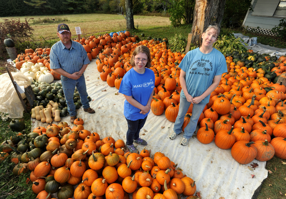 Abbie Clark, center, recipient of the Make-A-Wish Foundation, stands for photo with Dan Ring, left, and wife Allison Ring, right, at Ring Family Farm in Canaan on Tuesday. Ring Family Farm will host its 6th annual fall event to raise money for the Make-A-Wish Foundation on Saturday.