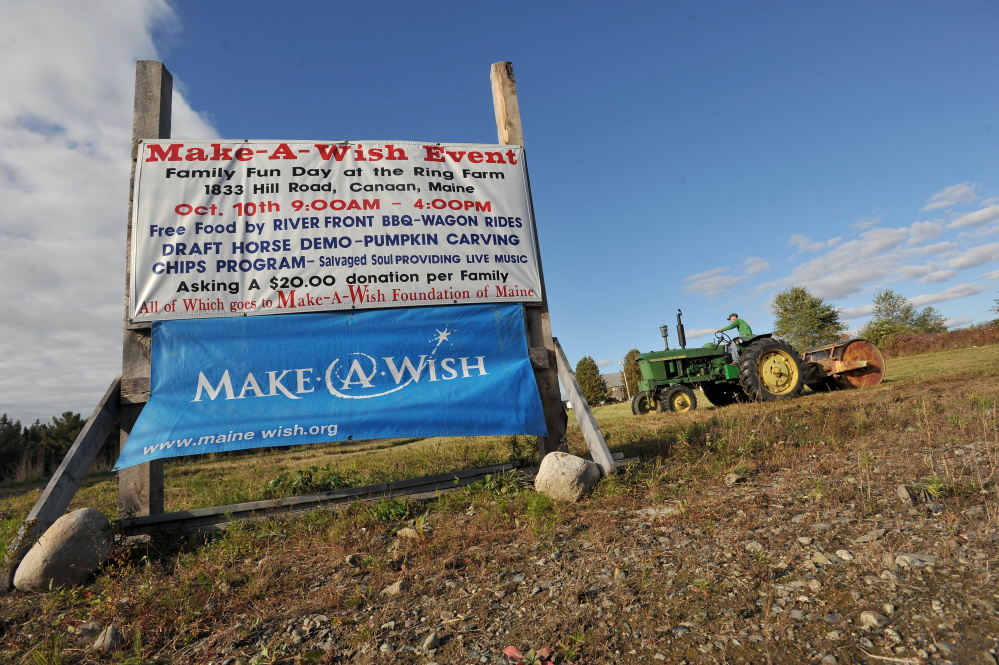 Will Ring compacts the grass for parking at the Ring Family Farm in anticipation of Saturday's 6th annual Make-A-Wish Foundation fundraiser in Canaan on Tuesday.