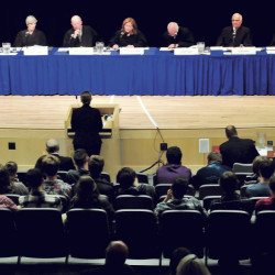 Students and staff at Mt. Blue High School in Farmington listen the Maine Supreme Judicial Court at the conclusion of arguments on Wednesday. From left are Justices Jeffrey Hjelm, Ellen Gorman, Donald Alexander, Chief Justice Leigh Saufley, Andrew Mead, Joseph Jabar and Thomas Humphrey.