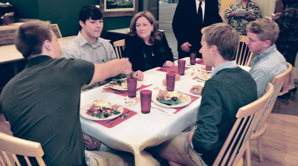Chief Justice Leigh Saufley of the Maine Supreme Judicial Court shakes hands with Mt. Blue High School student Miles Pelletier and other students during lunch following the court hearing arguments for appeals on Wednesday.