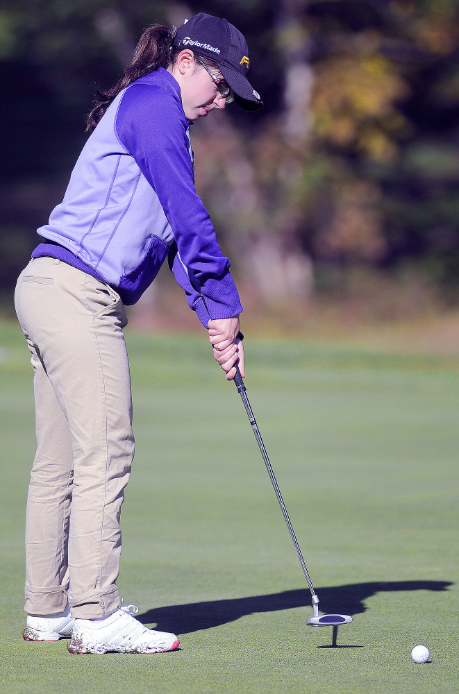Staff photo by Andy Molloy Carrabec High School's Katie Dixon putts during the Mountain Valley Conference state golf qualifier Wednesday at Natanis Golf Course. Dixon shot a 103 to qualify for the individual schoolgirl state championship on Oct. 17.