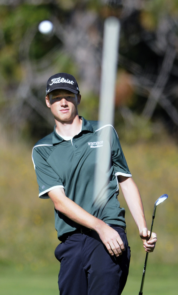 Staff photo by Andy Molloy Winthrop High School's Anthony Owens watches his shot on to a green during the Mountain Valley Conference state golf qualifier Wednesday at Natanis Golf Course. Owens shot an 83 to finish second overall.