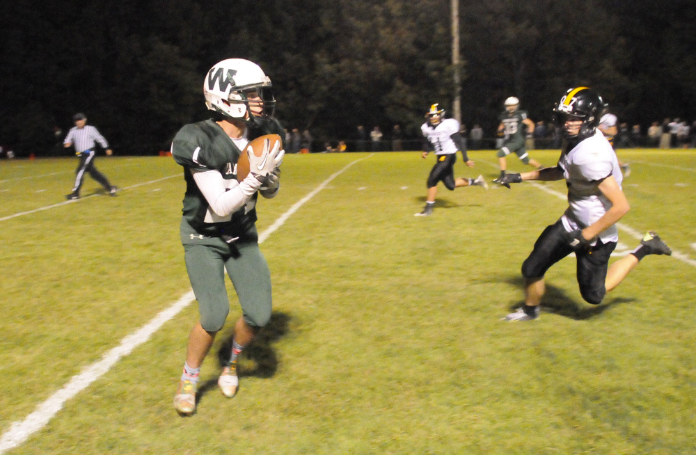 Winthrop/Monmouth's Bennett Brooks, left, catches a pass in front of Maranacook's Levi Emery during a game this season.