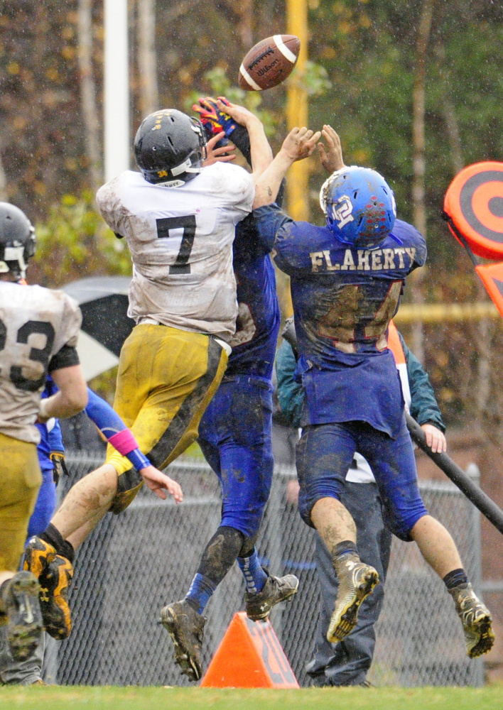 Marancook's Levi Emery tries to haul in a pass during a Campbel Conference playoff game last season at Oak Hill.