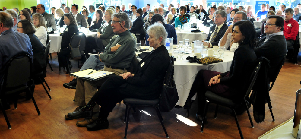 People with area businesses and organizations listen to speakers during a Business Breakfast series on development at Thomas College in Waterville on Thursday.