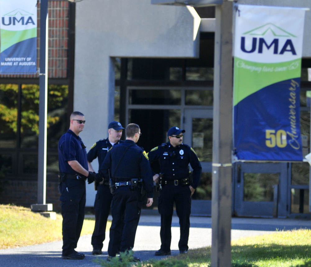 Police walk outside the Katz Library at the University of Maine at Augusta Thursday afternoon.